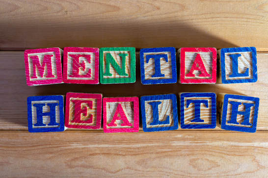 The words mental health spelled out in wooden letter blocks